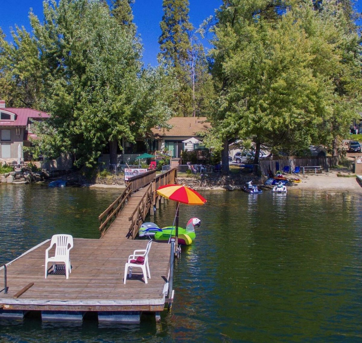 Dock in the water at this Incredible Lakefront Bass Lake Home for Sale Rick Allen Bass Lake Realty January 25, 2019